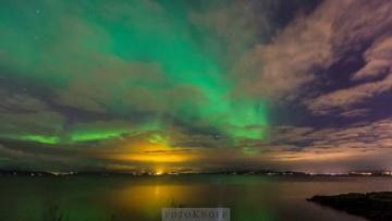 Aurora Borealis; Northern Lights in Trondheim Fjord and Trondheim, Norway, October 30. 2013
