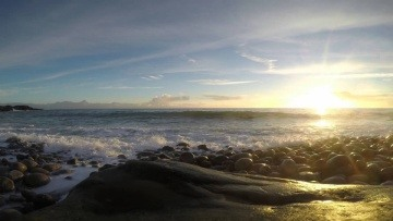Beautiful sunset at North Sea Mølen Norway (rocky beach)